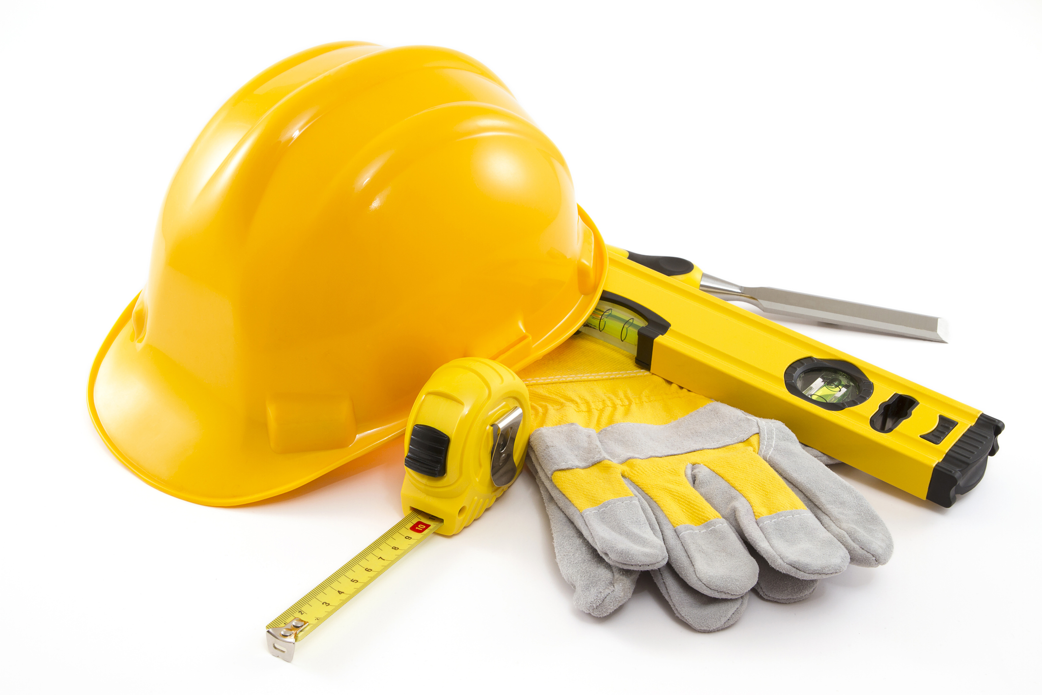 Assorted construction tools: work gloves, plumb level, hard hat.